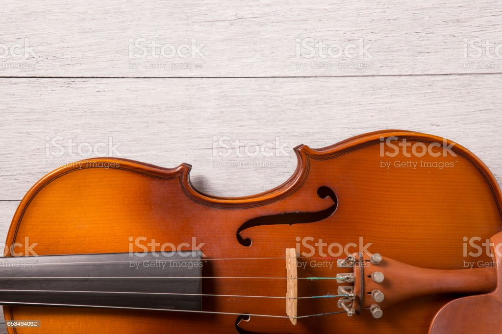still life of vintage violin on white wooden background stock photo