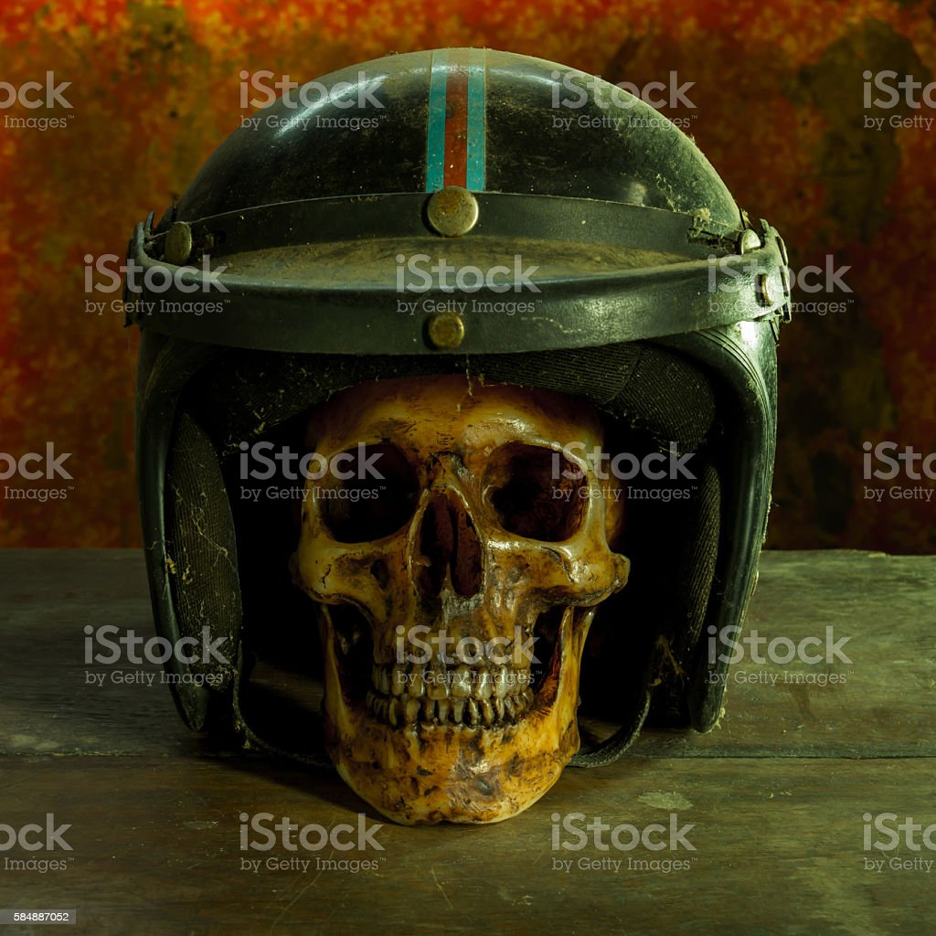 still life old skull helmet stock photo