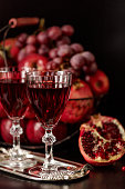 Still life on a dark background. Wine (liquor) glasses