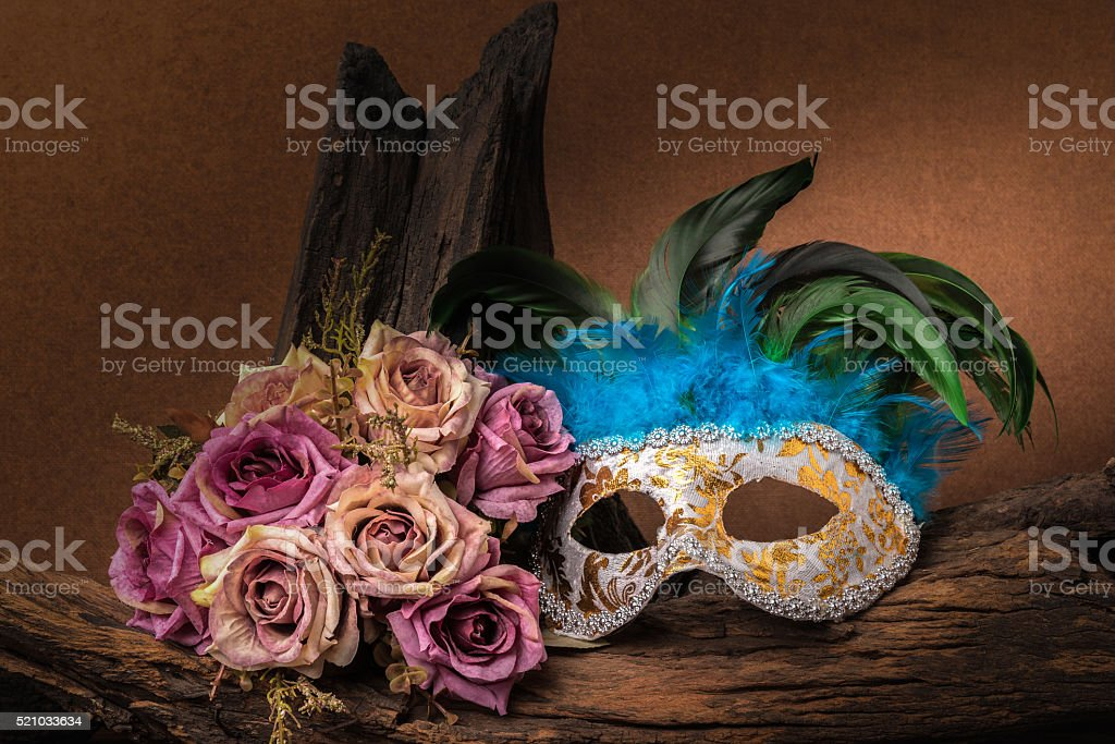 Still life painting photography with carnival mask and roses stock photo