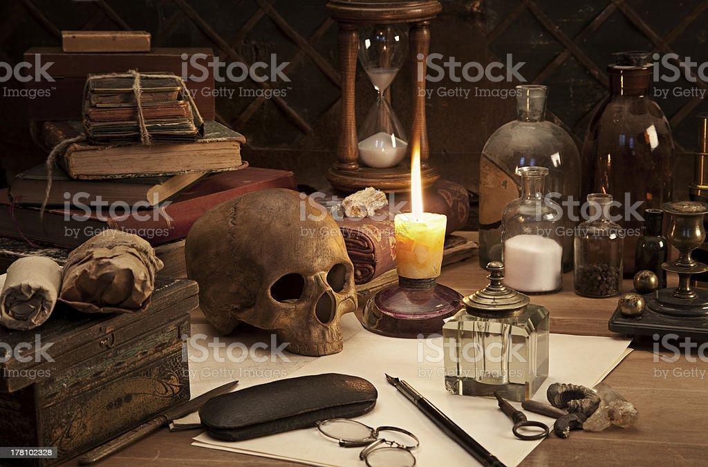 A still life photo of an alchemist's desk stock photo