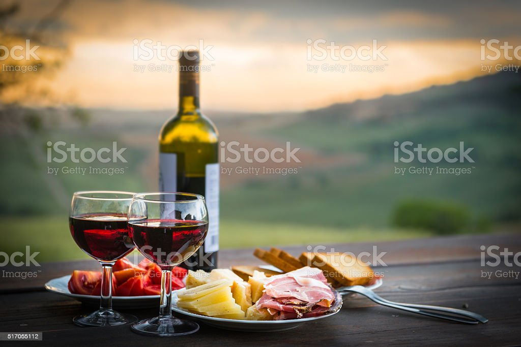 still life Red wine  ,cheese and prosciutto stock photo