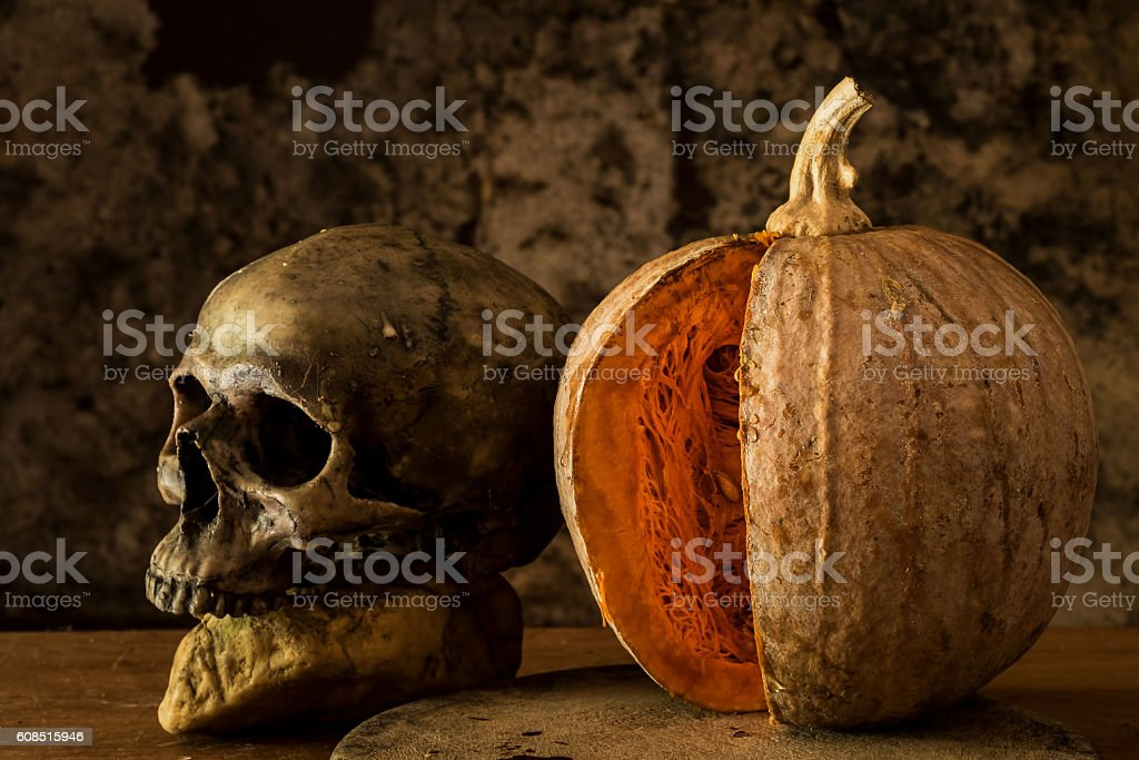 Still Life Skull and pumpkin on the table. stock photo