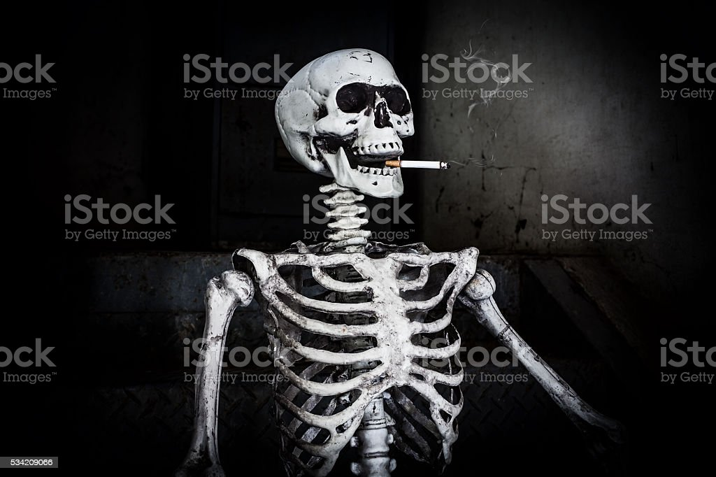 Still life Smoking human skeleton with cigarette stock photo