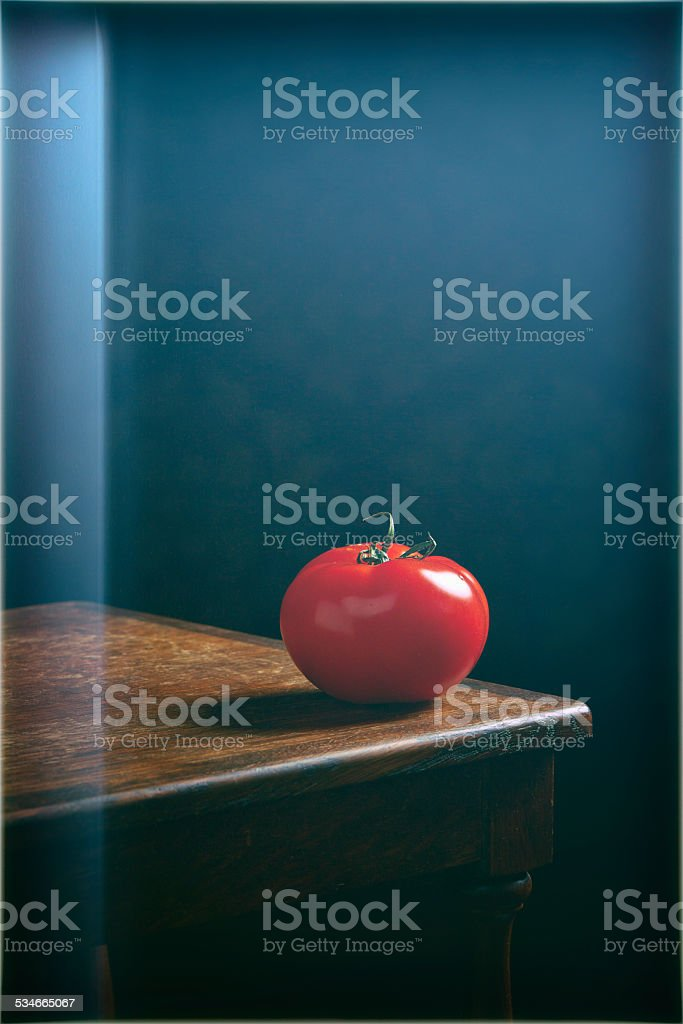 Still life, Tomato on wooden oak table with lens flare stock photo