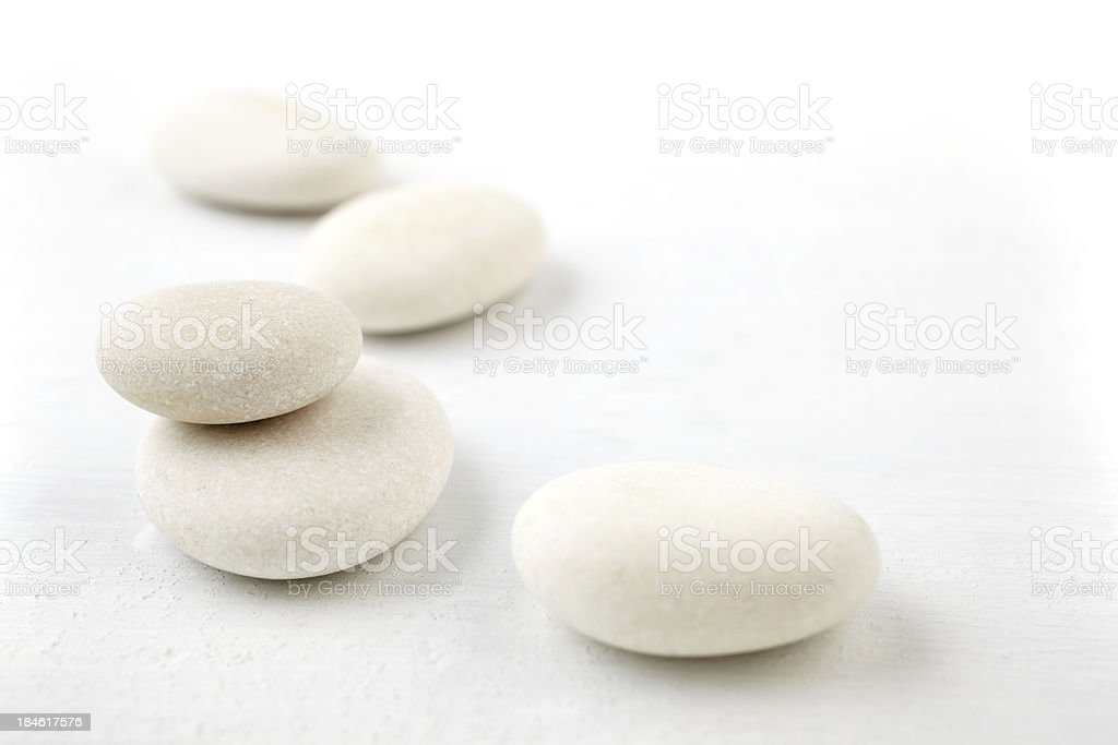 Still life white rocks on linen surface with copy space stock photo