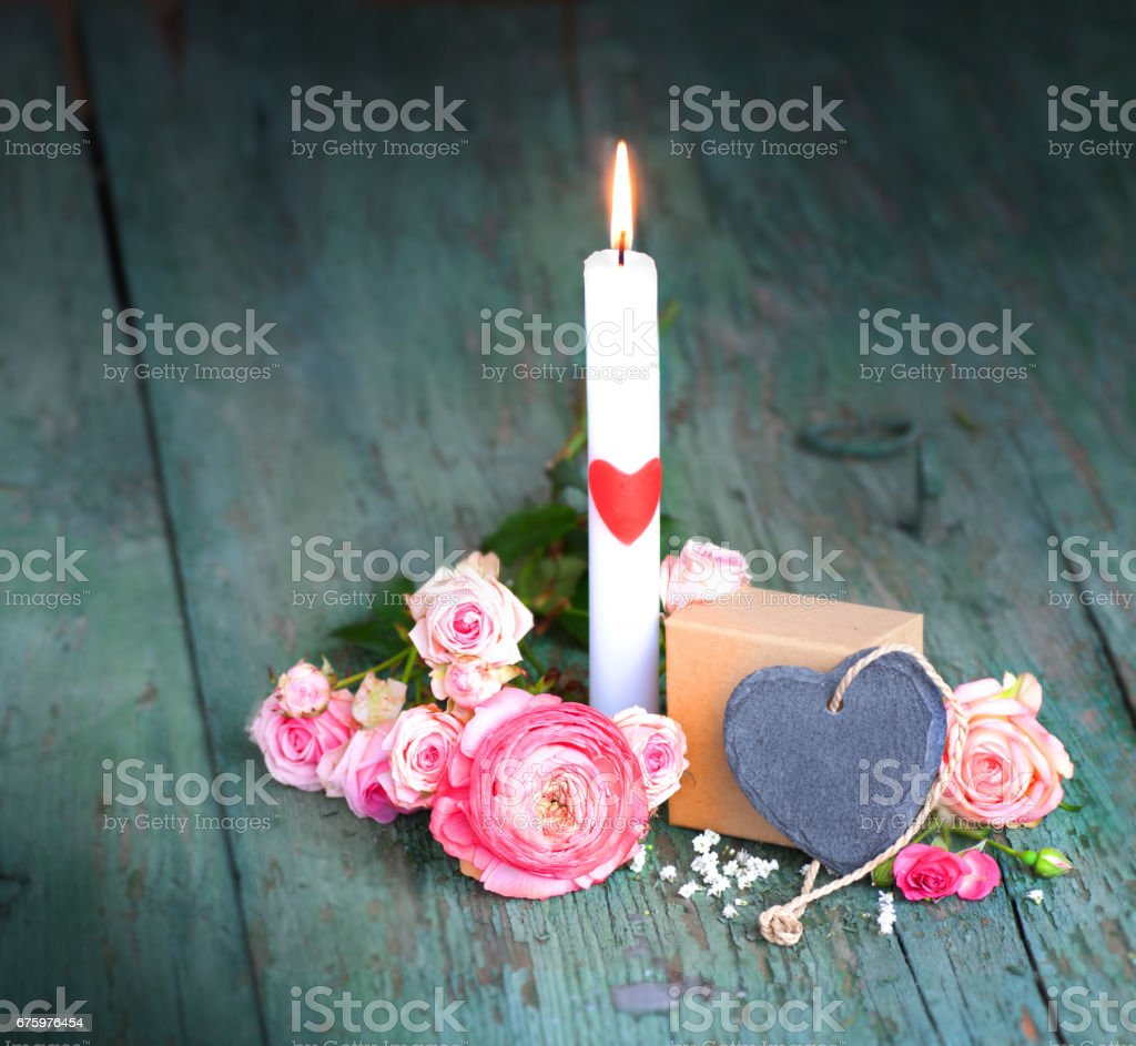 Still life with a candle for mothers day stock photo