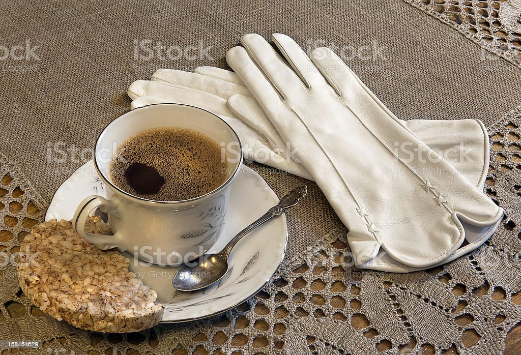 Still life with a Cup of coffee and gloves royalty-free stock photo