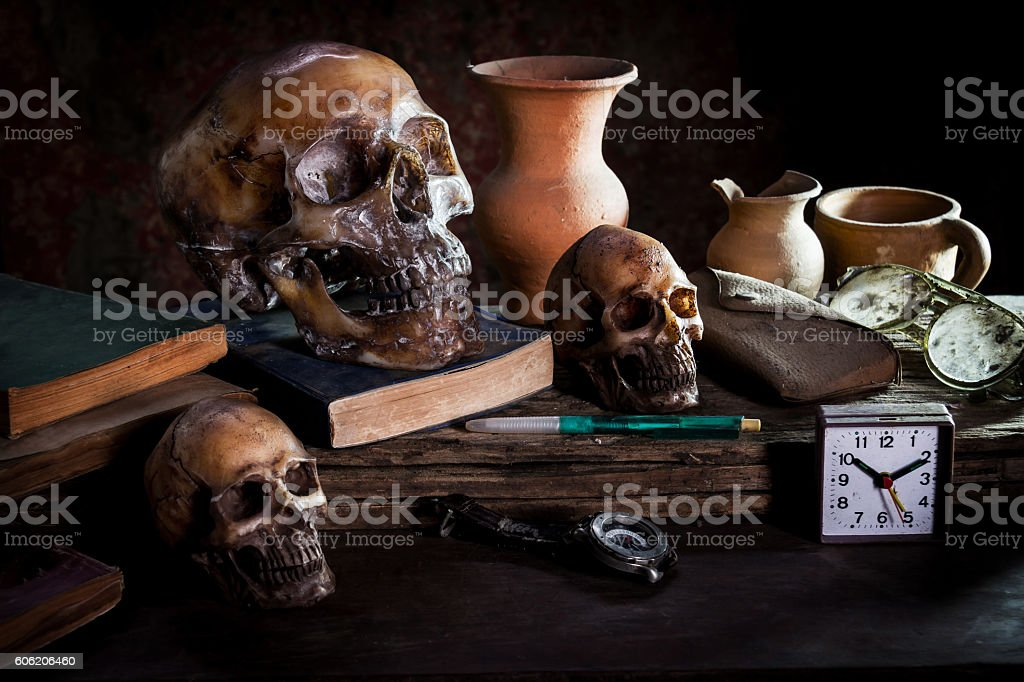 Still Life with a Skull and fruit on wooden stock photo
