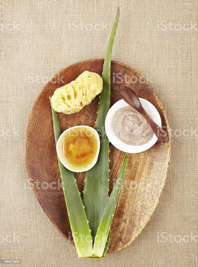 Still life with aloe vera, sugar scrub, honey royalty-free stock photo