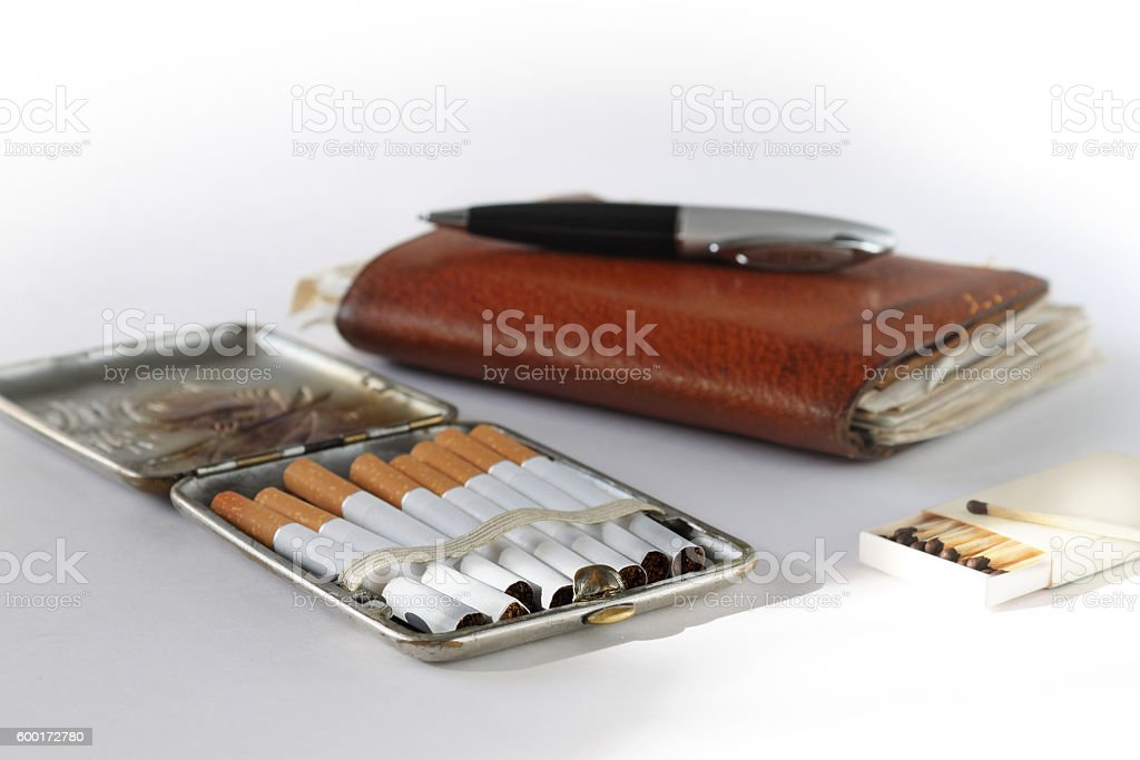Still life with an ancient cigarette case stock photo