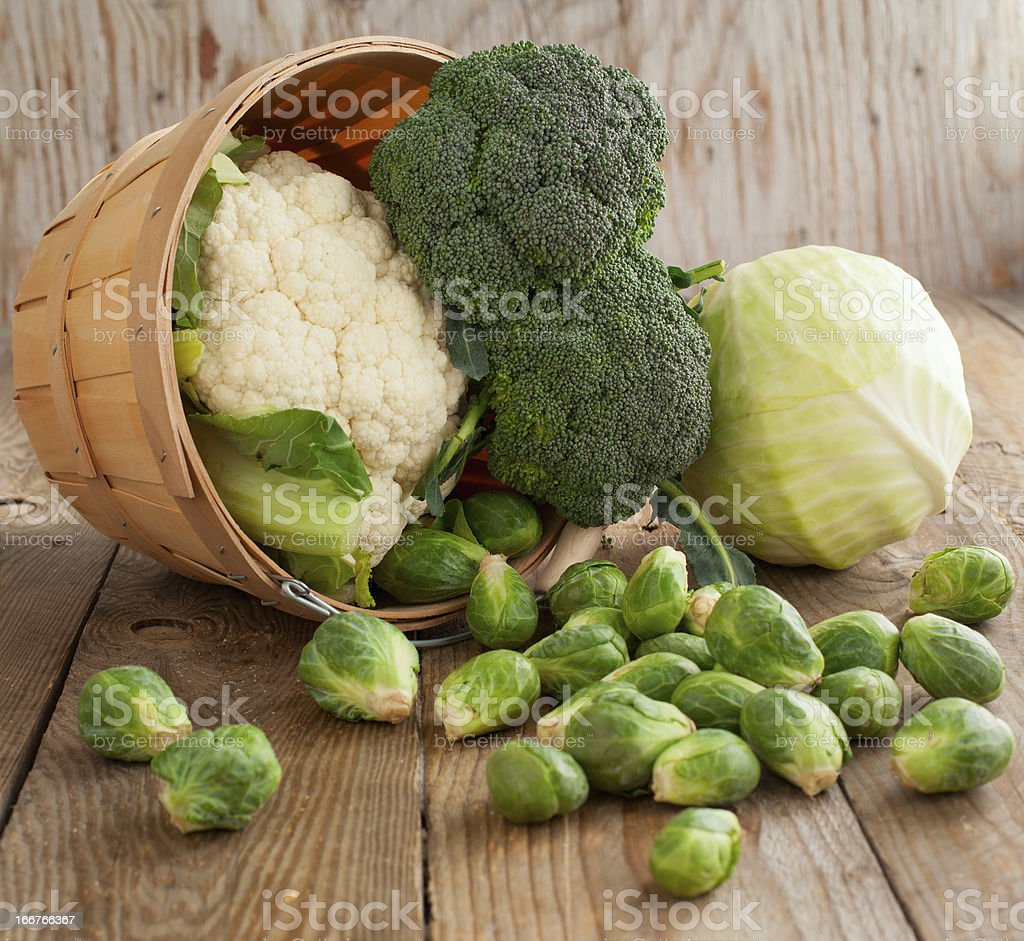 Still life with assortment cabbages on wooden background stock photo