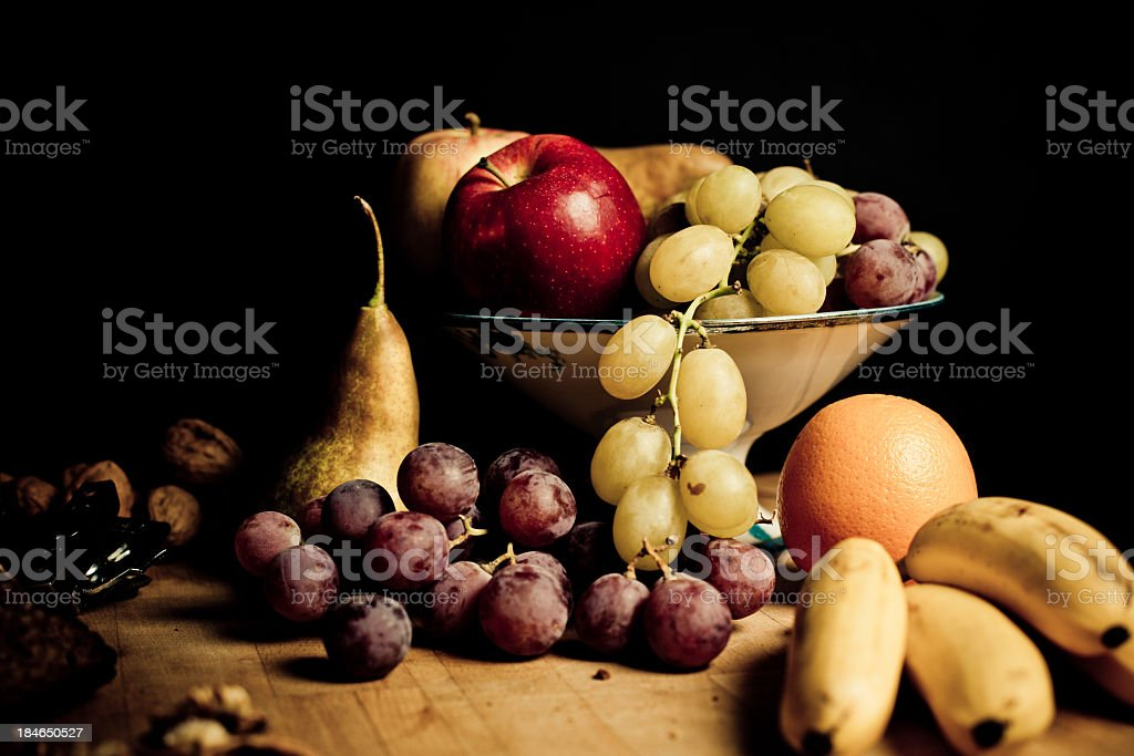 Still life with Autumn fruits and bananas royalty-free stock photo