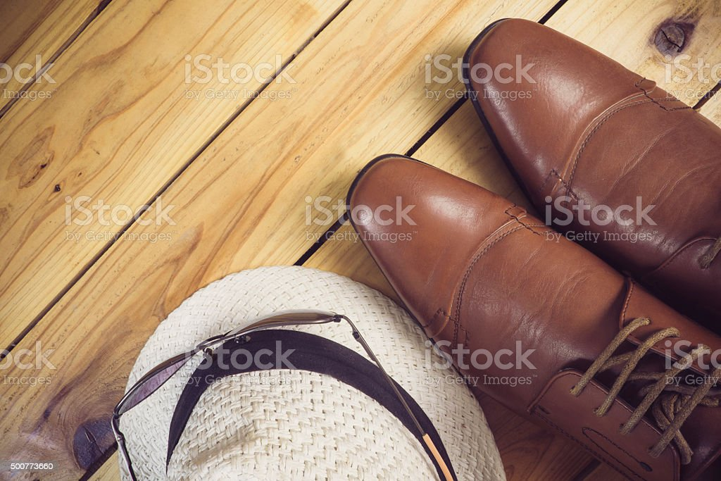 still life with boots with brown hat and sunglasses stock photo
