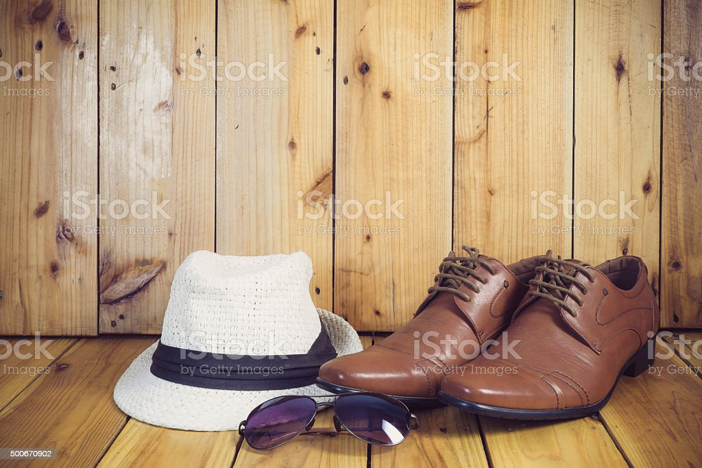 still life with boots with brown hat stock photo