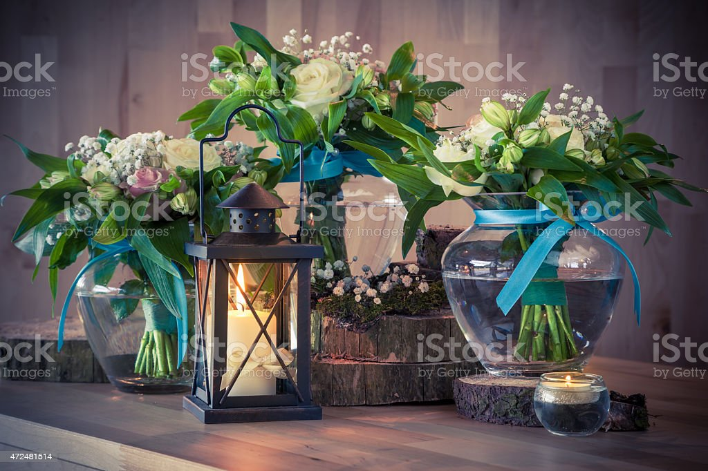 Still life with bouquets and candles stock photo