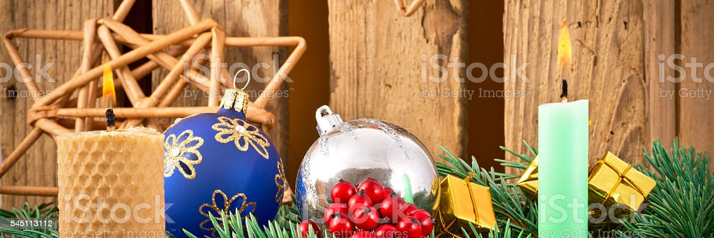 still life with candles and Christrmas decoration stock photo