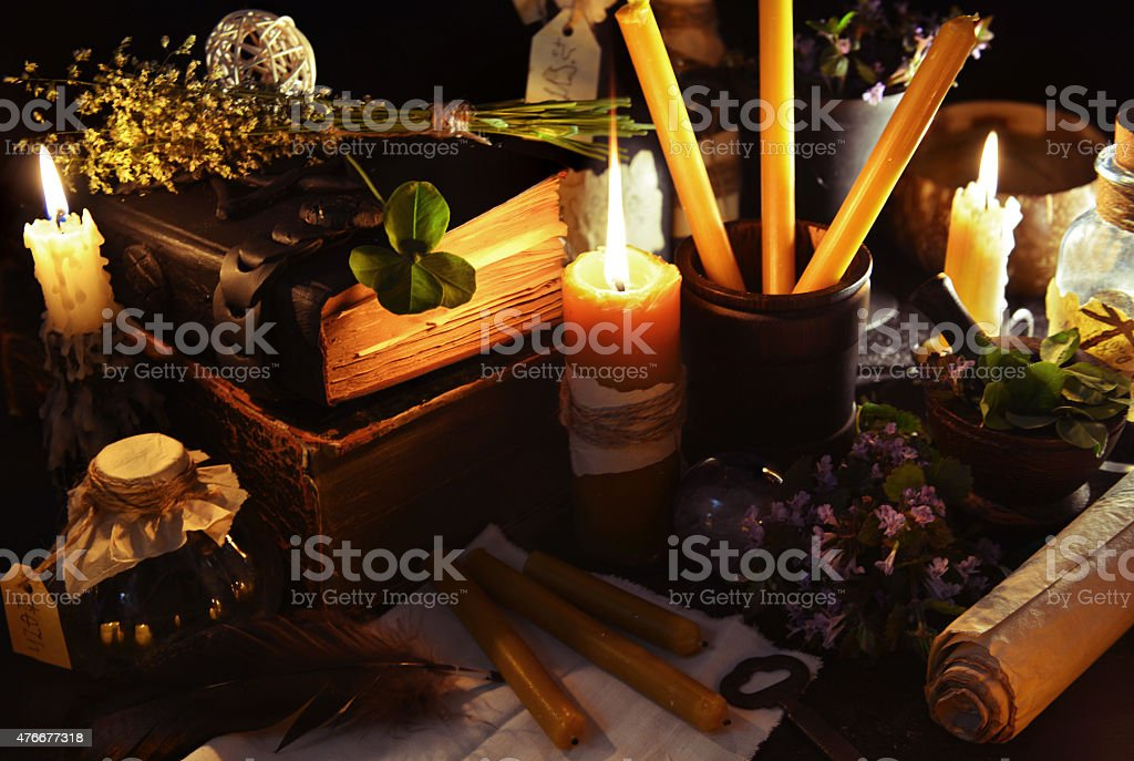 Still life with candles, books and healing herbs stock photo