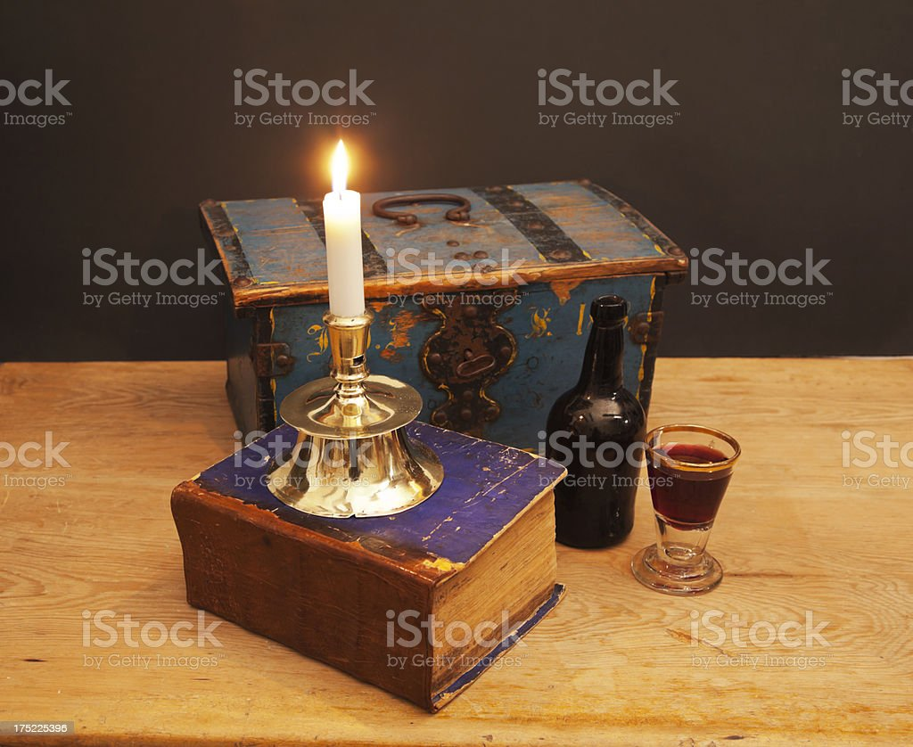 Still life with candlestick and old book. stock photo