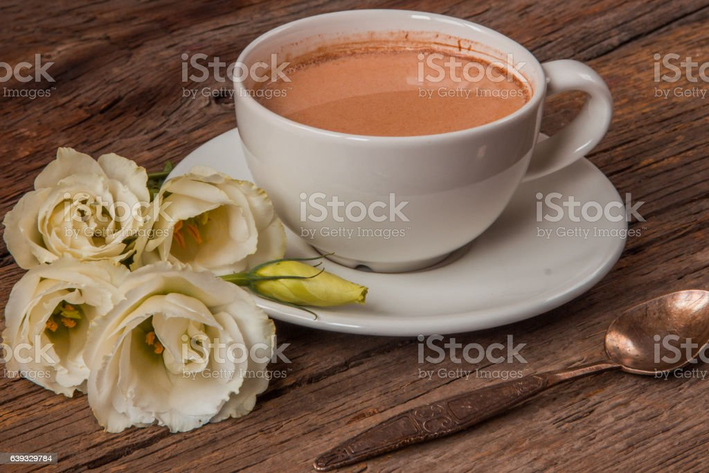Still life with cup of coffee and flowers Eustoma stock photo