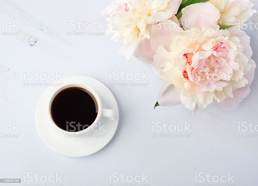 Still life with cup of coffee and flowers stock photo