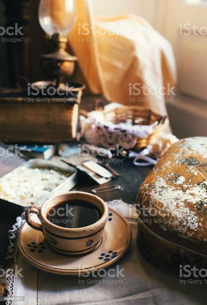 Still life with cup of coffee and vintage sewing accessories stock photo