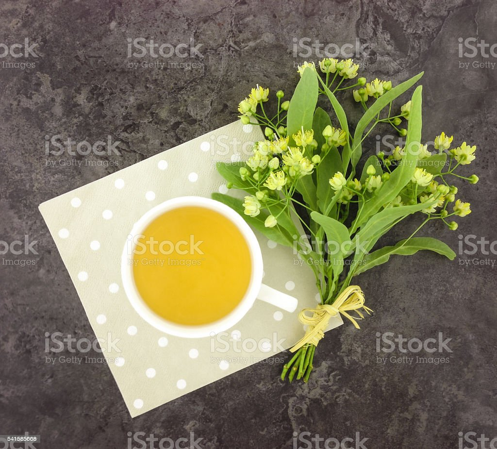 Still life with cup of tea and flower bouquet stock photo