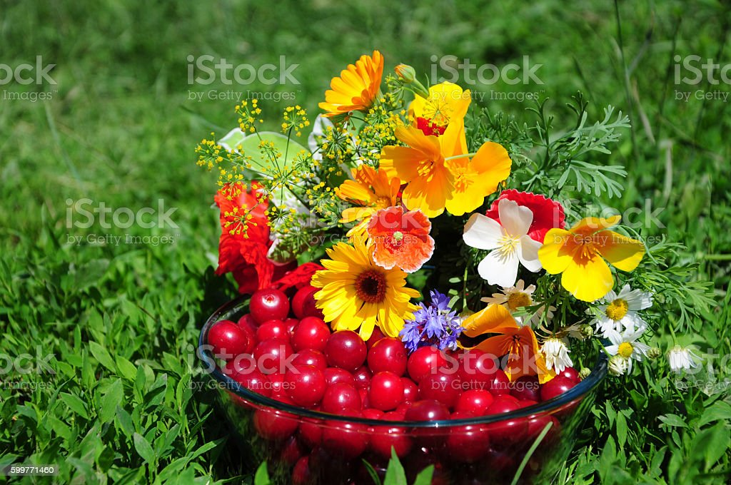 Still life with flowers and cherry stock photo