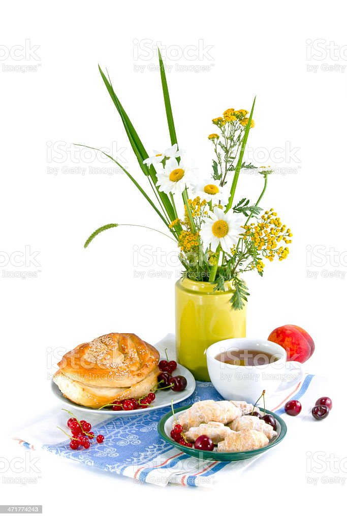 still life with flowers and red currant bun royalty-free stock photo