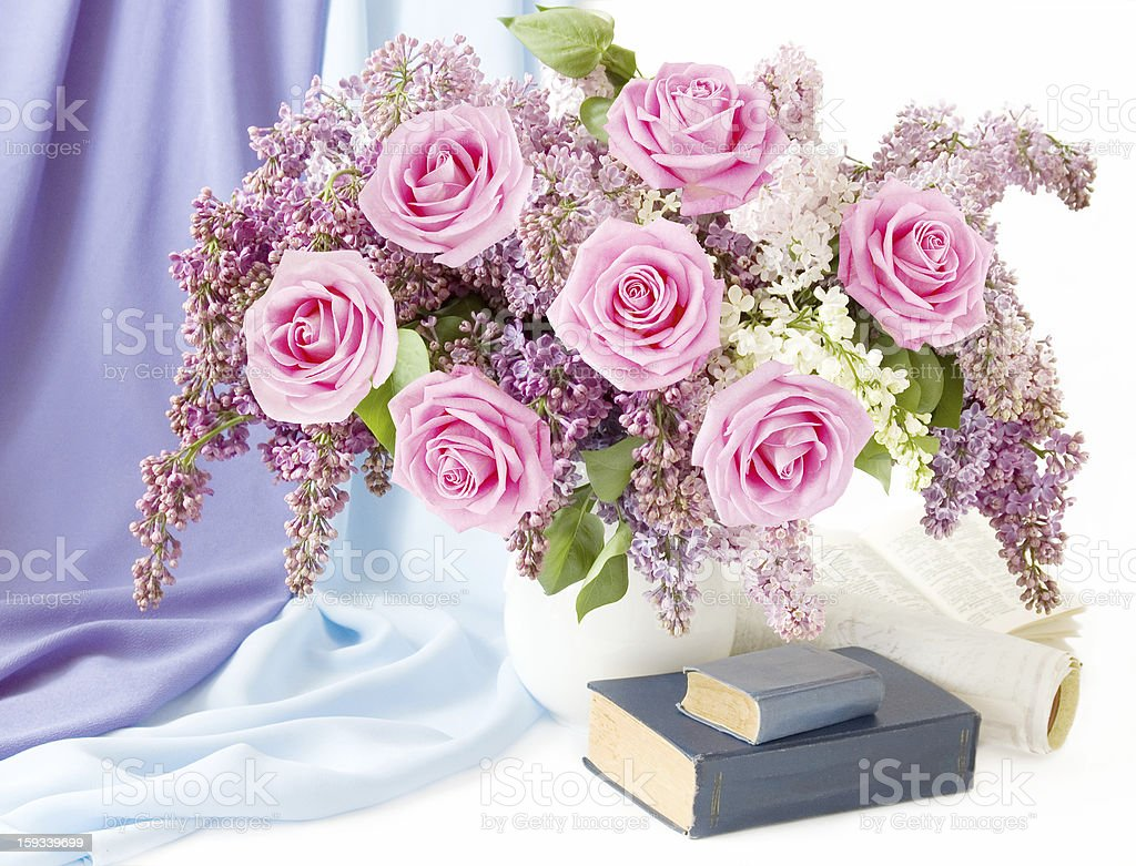 Still life with flowers bunch and books stock photo
