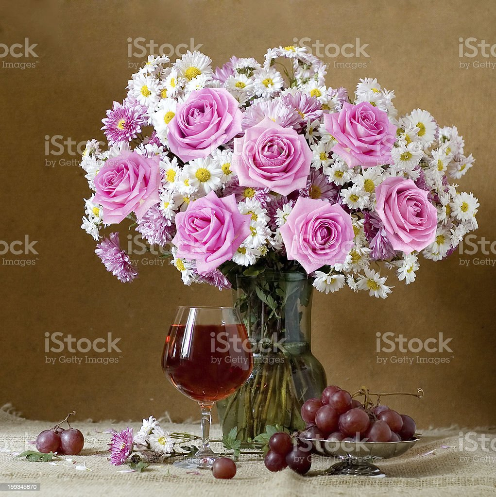 Still life with flowers bunch, wine and fruits stock photo