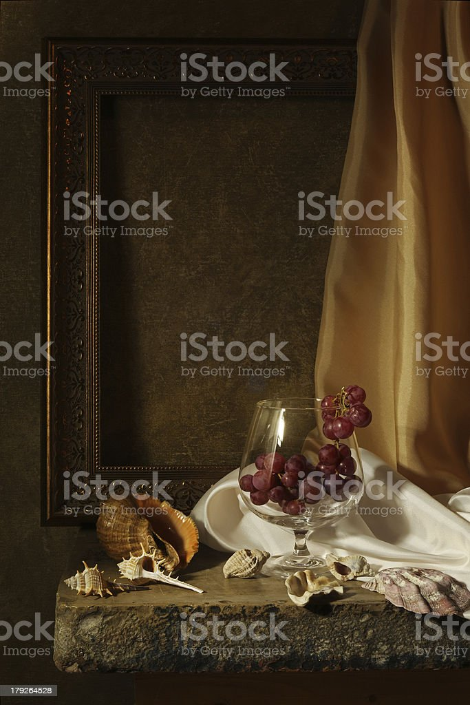 Still Life with Grapes and seashells royalty-free stock photo