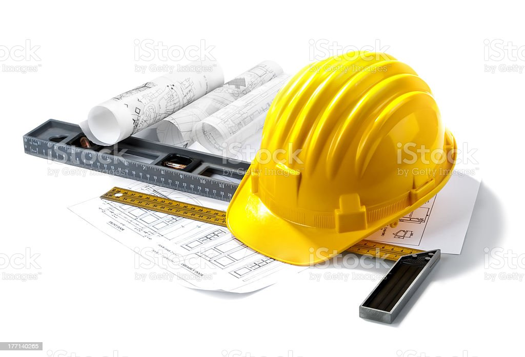 still life with hard hat and blueprints stock photo