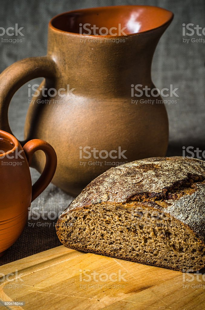 Still life with homemade bread and pottery stock photo