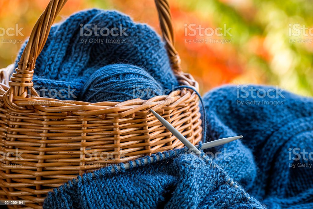 Still life with knitting and basket stock photo
