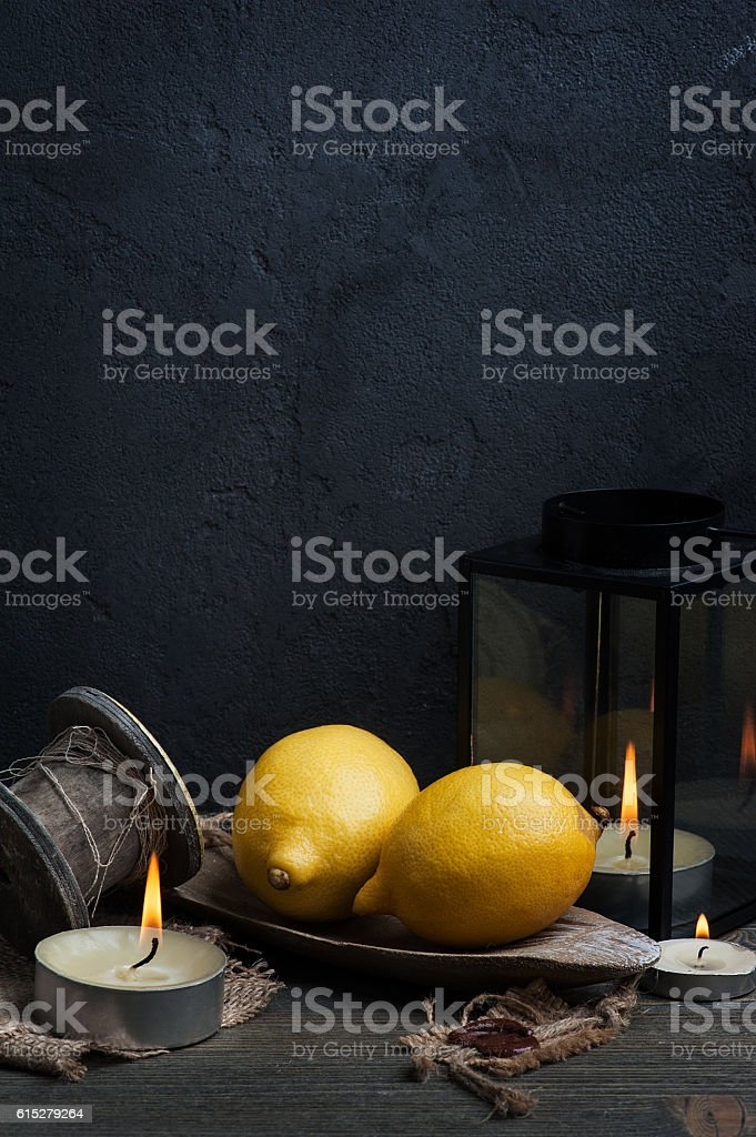 Still life with lemons and candles stock photo