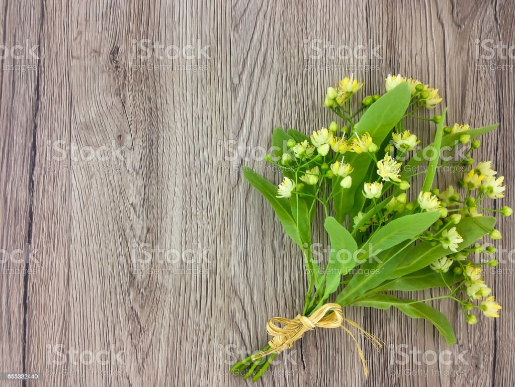 Still life with linden flowers bouquet. Flat lay, top view stock photo