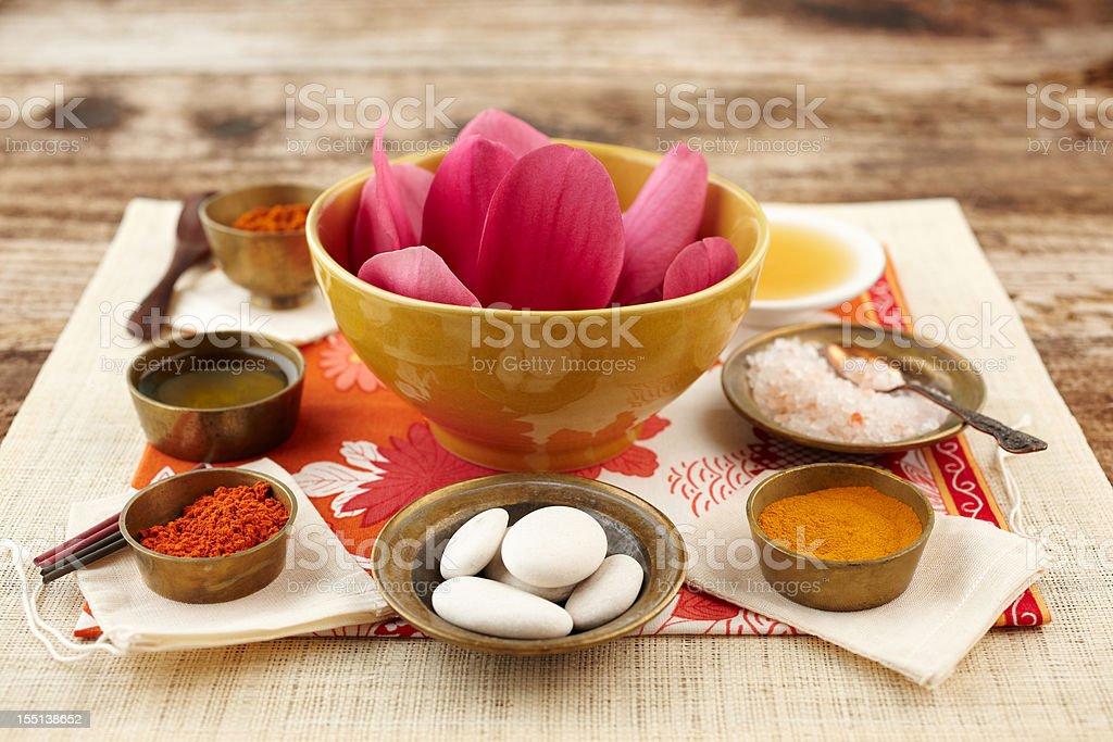 Still life with Magnolia Flower, turmeric and sandalwood powder, scrubbing royalty-free stock photo