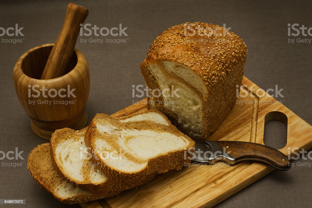 Still life with marble bread and a mortar stock photo