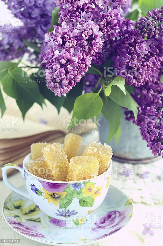 Still life with marmalade candies and lilac flowers royalty-free stock photo