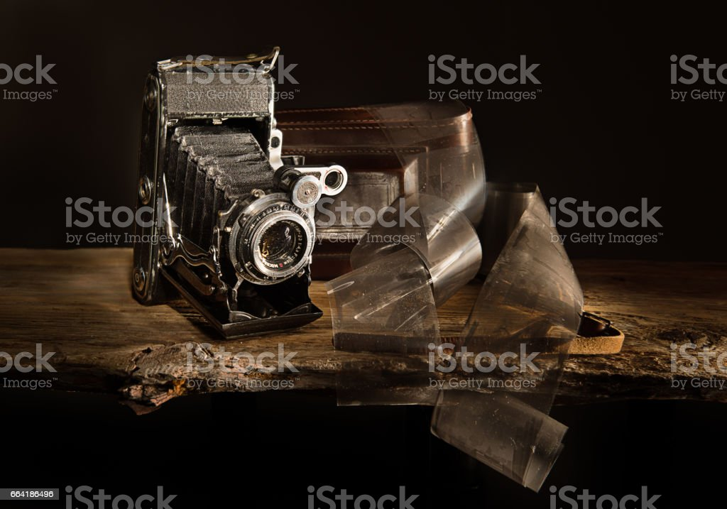 Still life with old photo camera and films stock photo