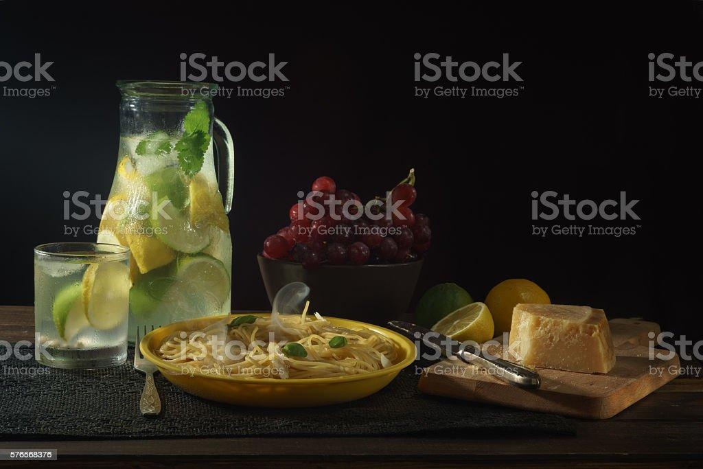 Still life with pasta on dark background stock photo