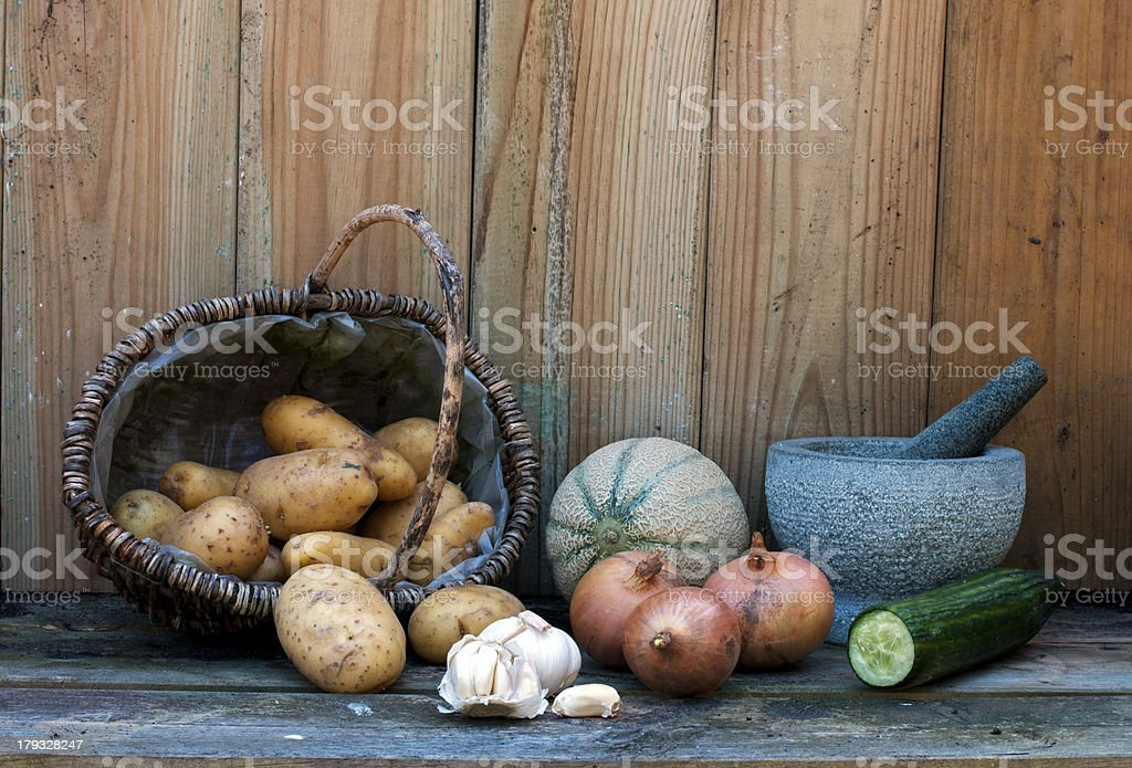 still life with patatoes onions and other fruit stock photo