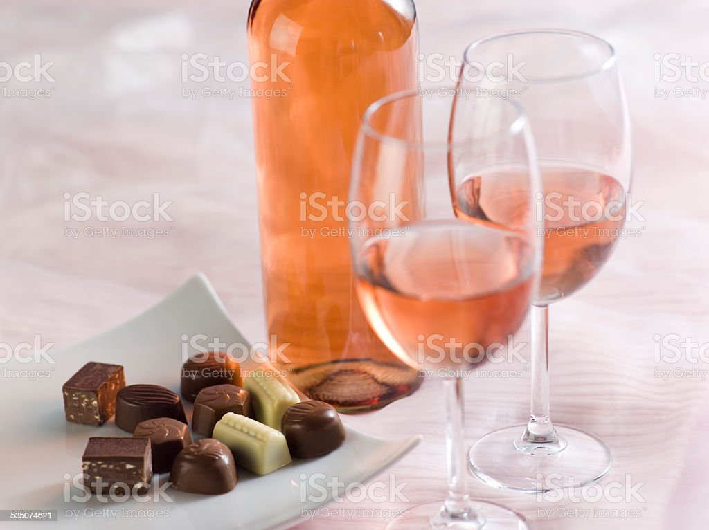 still life with pink wine and sweets stock photo
