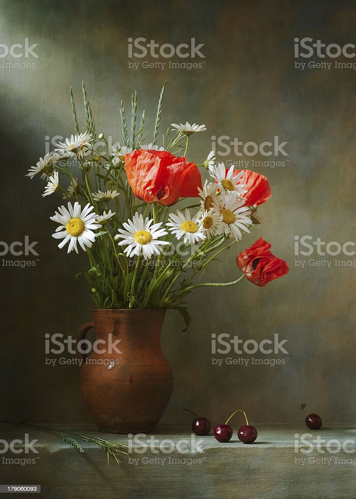 Still life with poppies in a vase sitting on a shelf stock photo