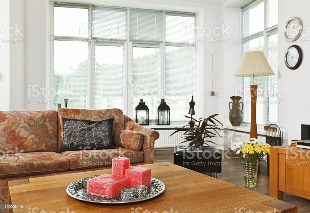 Still life with red rectangular candles on silver tray royalty-free stock photo