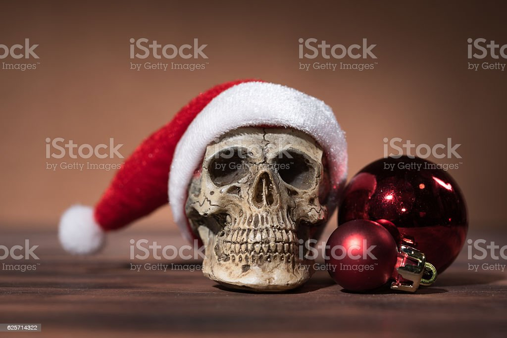Still life with santa claus skull and red christmas balls stock photo