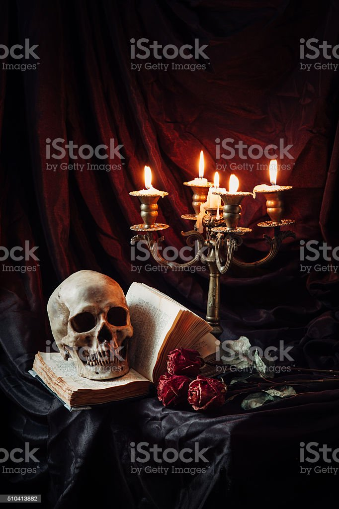 Still life with skull, book and candlestick stock photo