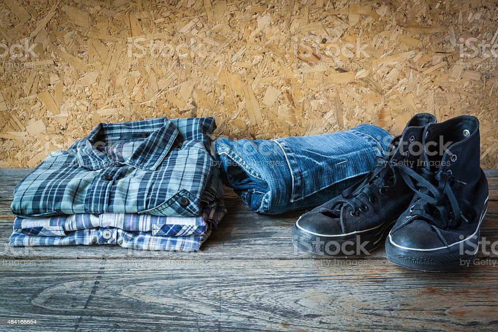 Still life with T- shirt jean and sneakers stock photo