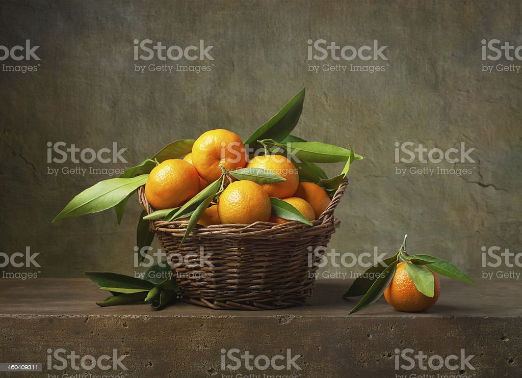 Still life with tangerines in a basket stock photo